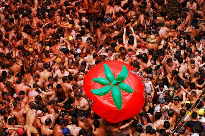 enjoy the tomatina festival in spain this august