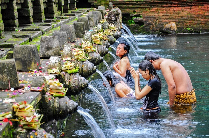 holy water ritual bath in bali temple