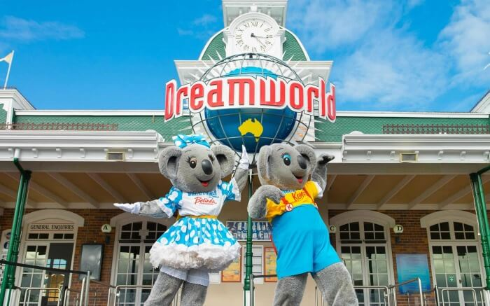 Two cartoon characters in front of Dreamworld theme park