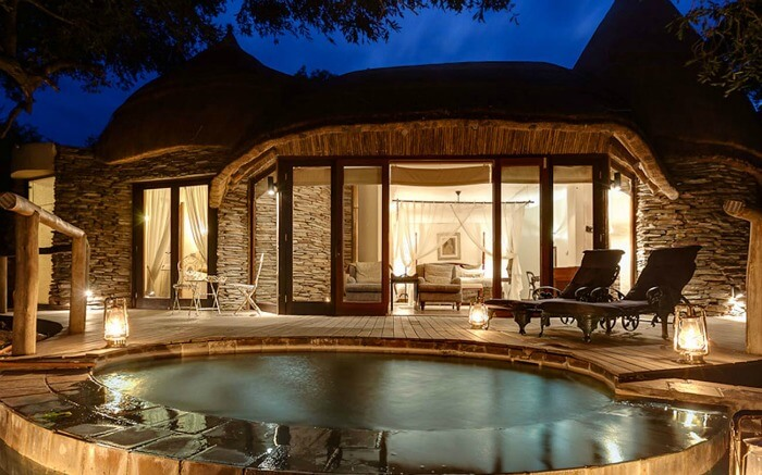 Well lit interiors and front pool view of Tintswalo Safari Lodge in Kruger National Park