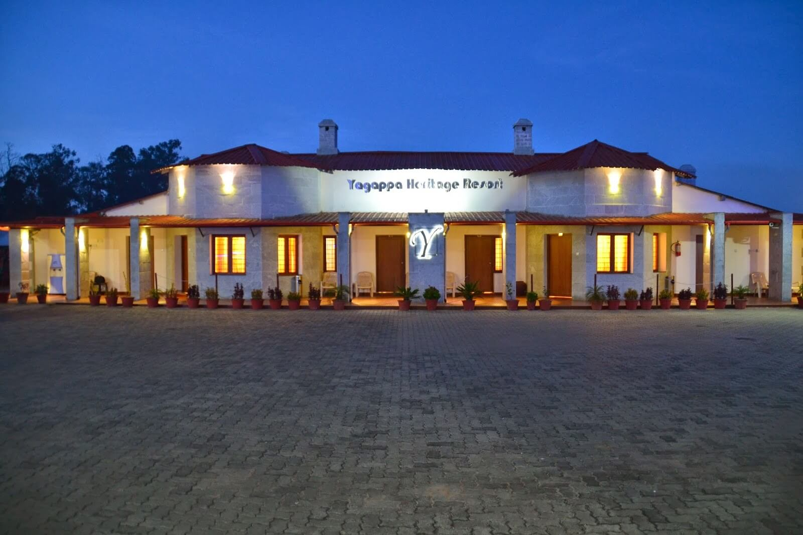 Well lit Yagappa Heritage Resort at night