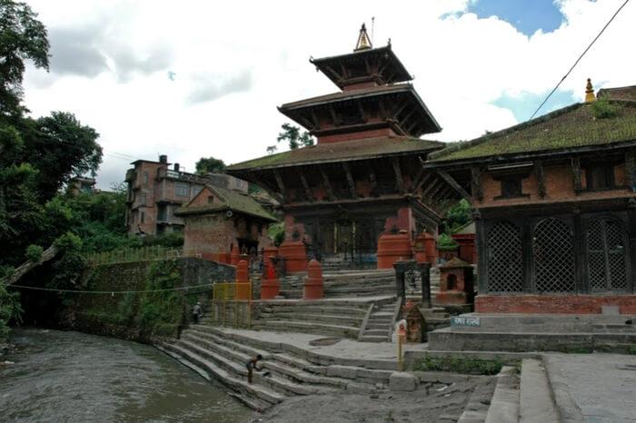 A pagoda style temple under a clouded sky