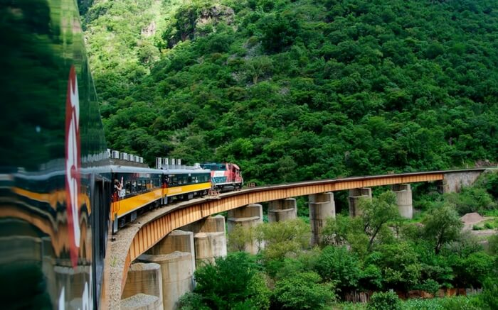An El Chepe train crossing a bridge in Mexico