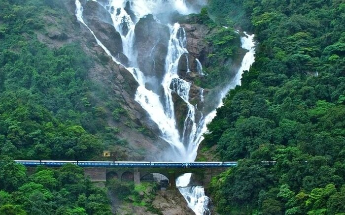 An Indian Railway train crossing the Dudhsagar Falls near Goa
