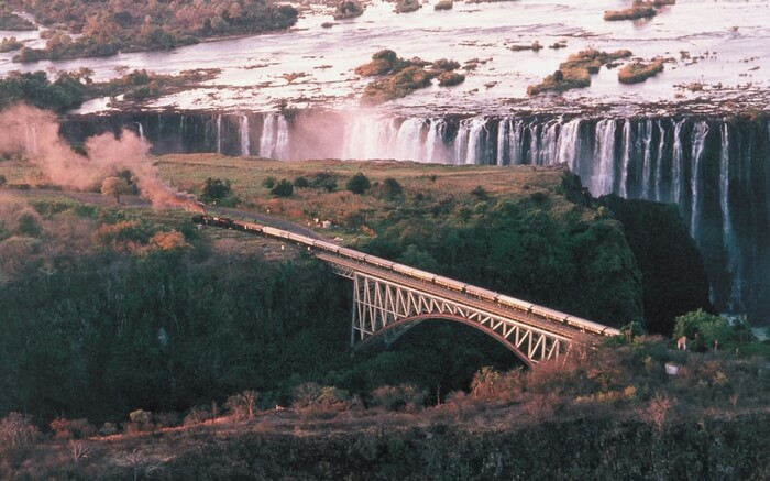 Aerial view of a Rovos Rail running past Victoria Falls in South Africa