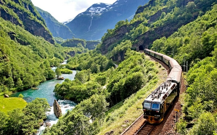 A train of Bergen Railway running across the mountains in Norway