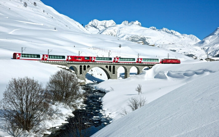 The Glacier Express crossing a bridge in the Swiss Alps