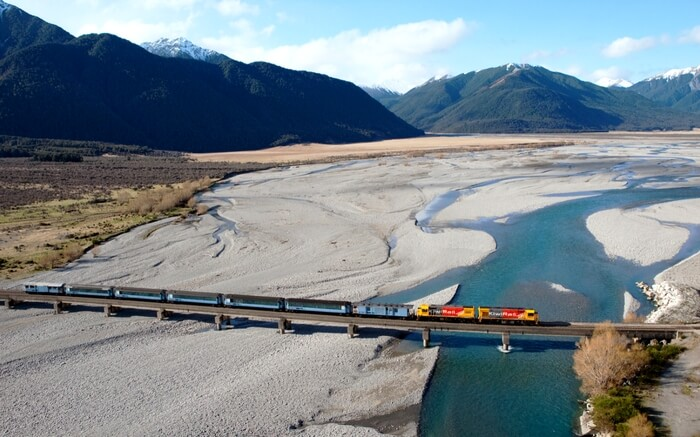A train of TranzAlpine crossing over a bridge in South Island