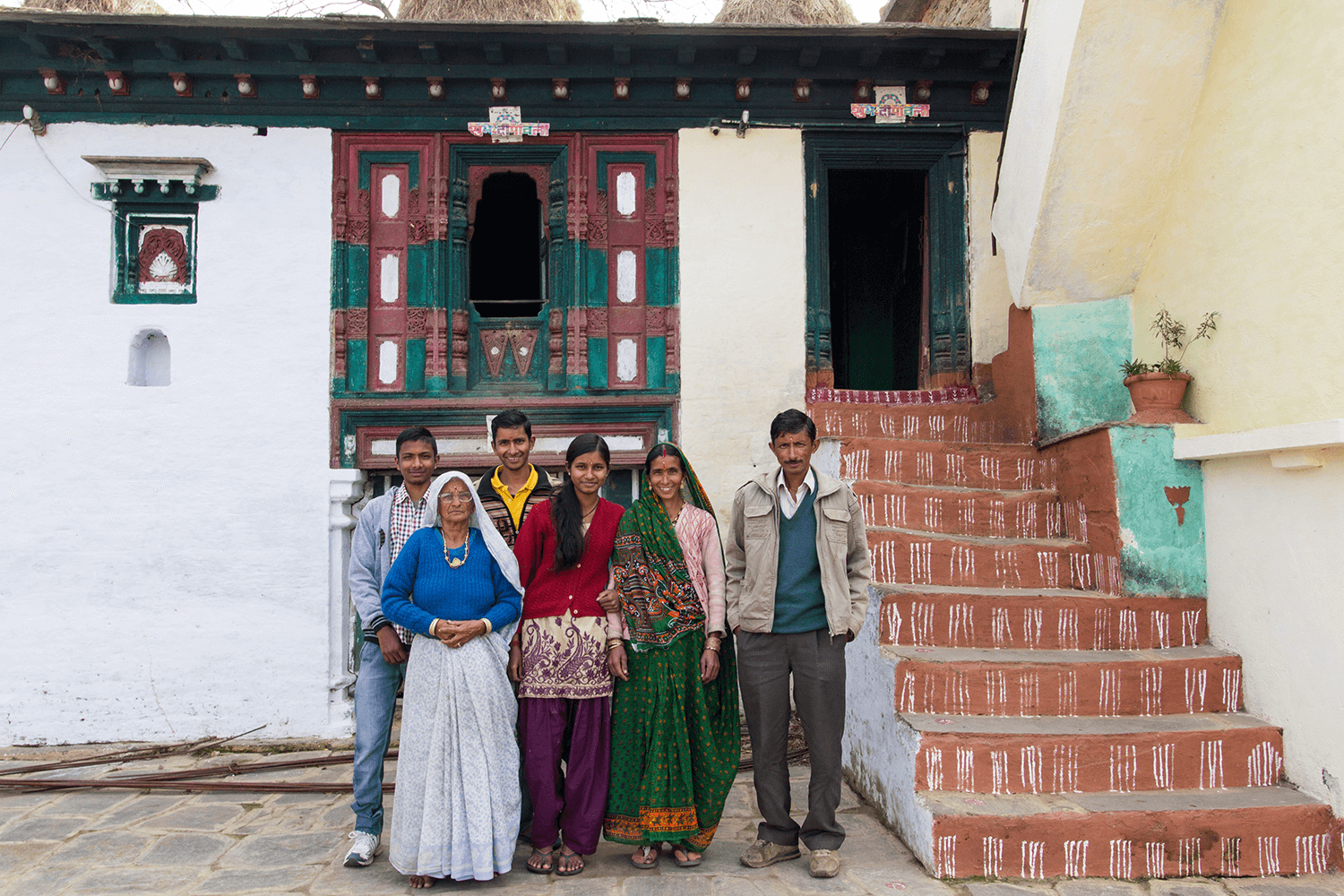 a mountain family standing in their old home ground