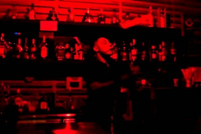 The bartender at Level 3 Bar in Mahe juggling drink bottles and glasses