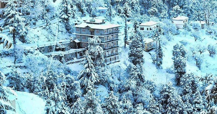 Snow-covered hills surrounding the Hotel Ekant in Chail