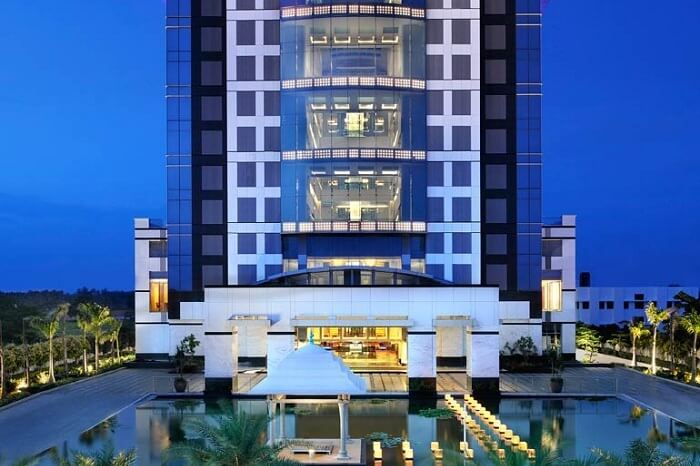 An evening shot of the main building of Le Meridien hotel in Coimbatore