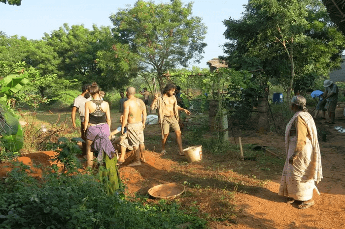 volunteers helping locals in a farm