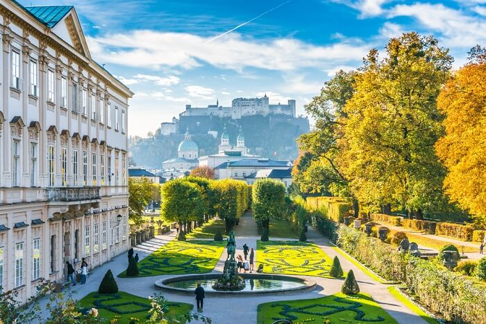 Beautiful view of famous Mirabell Gardens with the old historic Fortress Hohensalzburg in the background in Salzburg