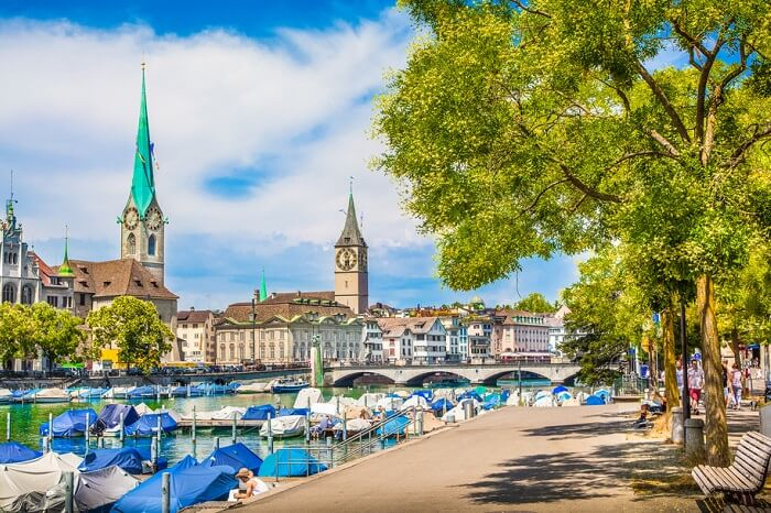Panoramic view from Lake Zurich of the historic Zurich city center with famous Fraumunster and St. Peter Churches