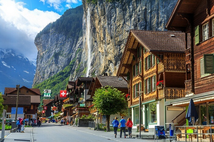 Spectacular principal street of Lauterbrunnen in Interlaken with stunning Staubbach waterfall in background