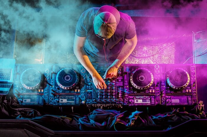 Charismatic disc jockey at the turntable of the Jungle nightclub in Praslin