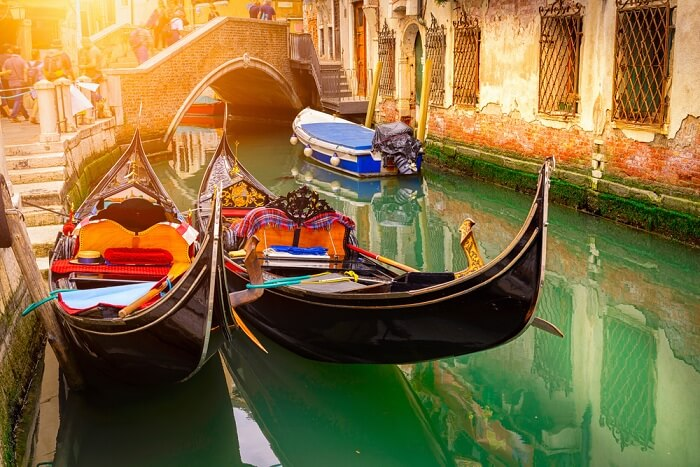 Canal with two gondolas at Venice in Italy