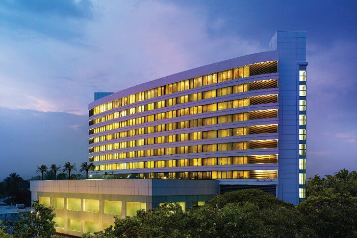 An evening shot of the main building of Vivanta by Taj hotel in Coimbatore