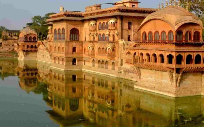A view of Deeg Palace surrounded by water in Rajasthan