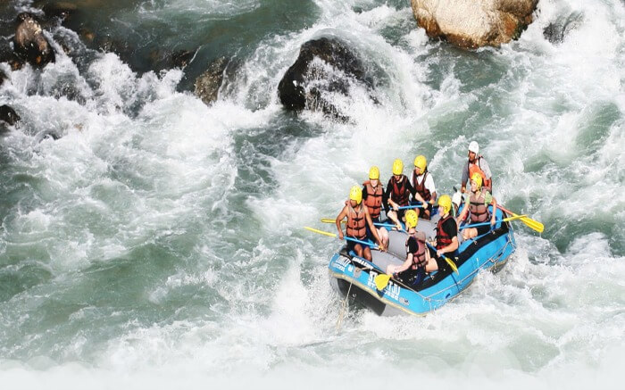 Adventurers fighting wave in Bheri river in Nepal