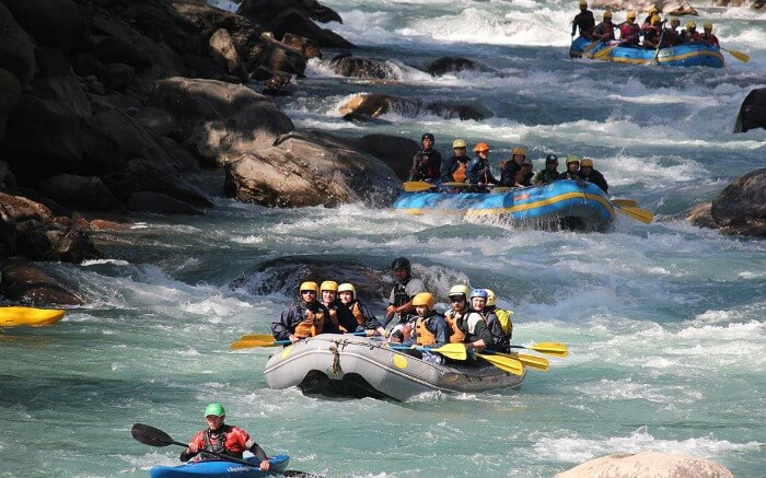 Adventurers rafting in a boat in a river in Nepal