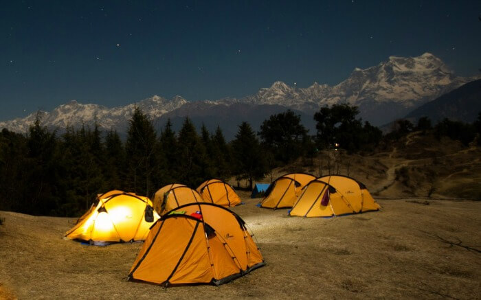 Camps near Chandratal with snowcapped peaks in the background