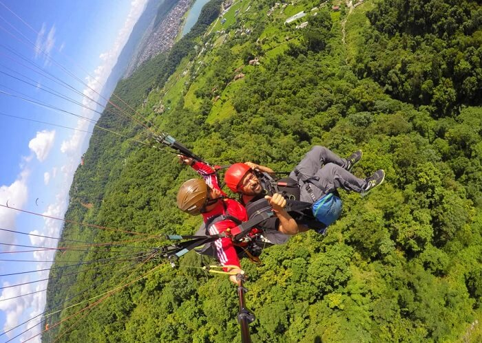 narayan paragliding in nepal on their romantic nepal vacation