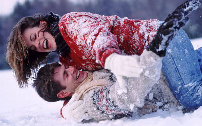 Couple enjoying snow in Kashmir