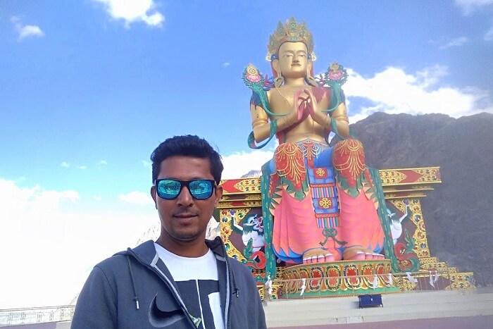 ninad near monastery and huge Buddha statue