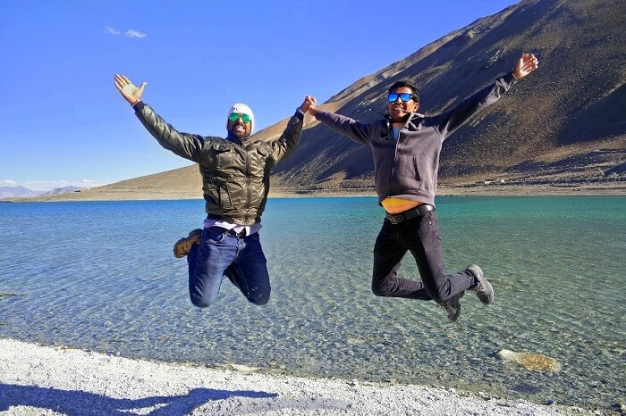 ninad and friend jumping near pangong lake