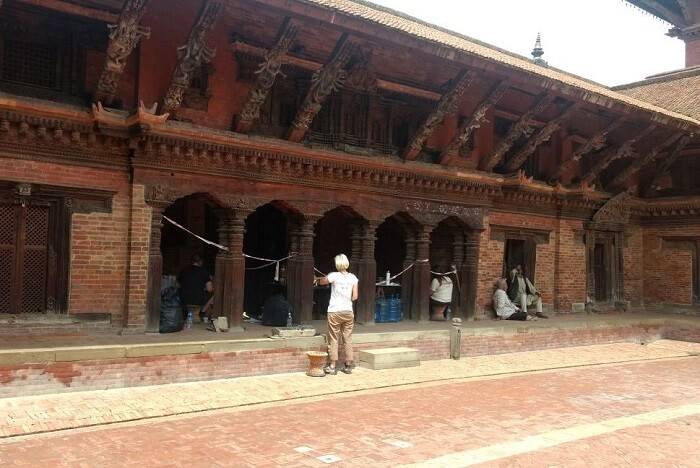 narayan and wife strolling in the interiors of nepal temple