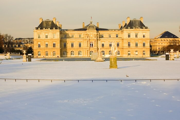 play in snow at the Luxembourg Gardens in paris in winter