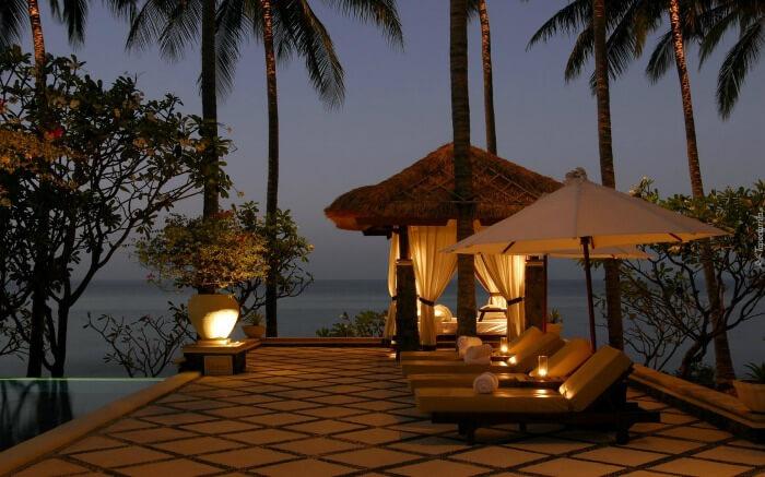 Seating area by the pool overlooking ocean in Canggu near Bali