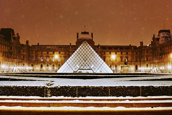 witness stunning works of art at The Louvre Museum in paris in winter