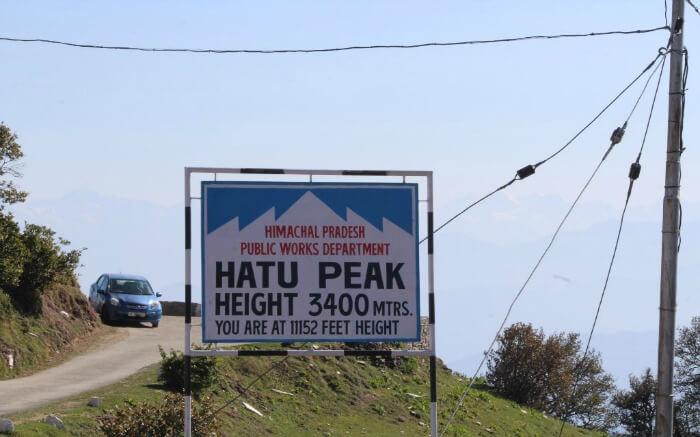 The signboard displaying the altitude of Hatu Peak
