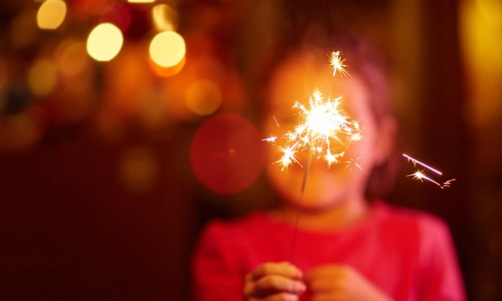 a kid burning sparkle