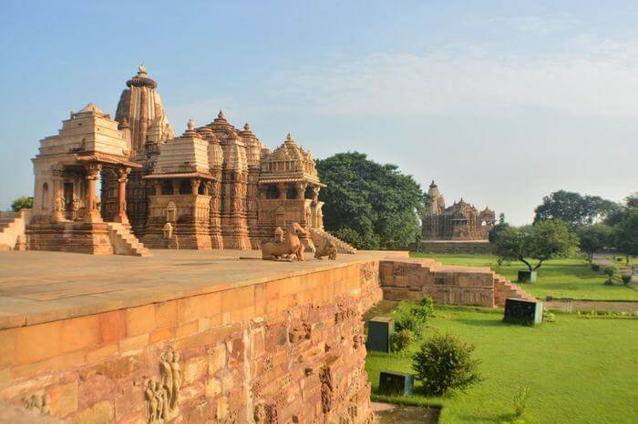 beautiful temple of Khajuraho with a green lawn