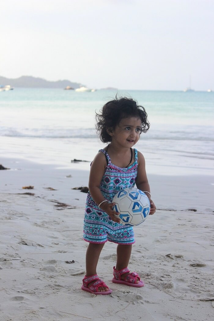 kid at a beach in seychelles
