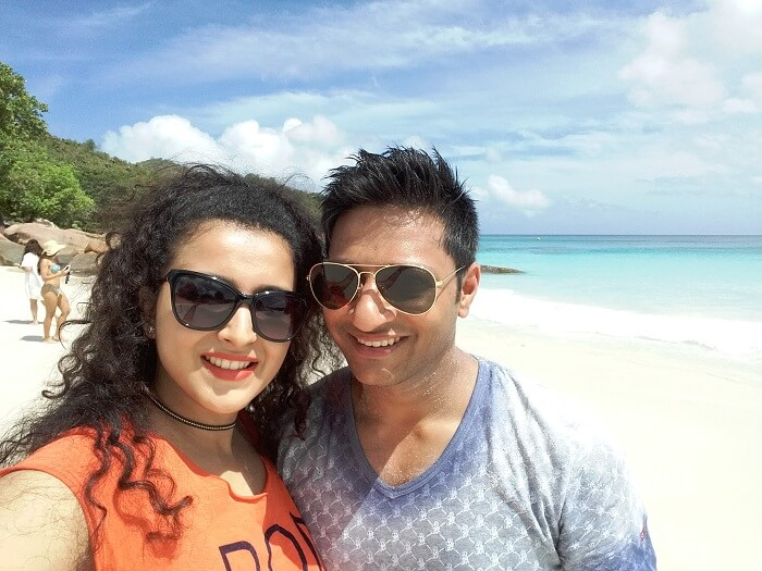 sulabh and his wife on a beach in seychelles
