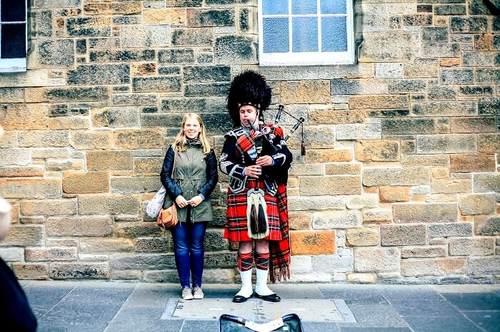 Highland Bagpiper in Scotland