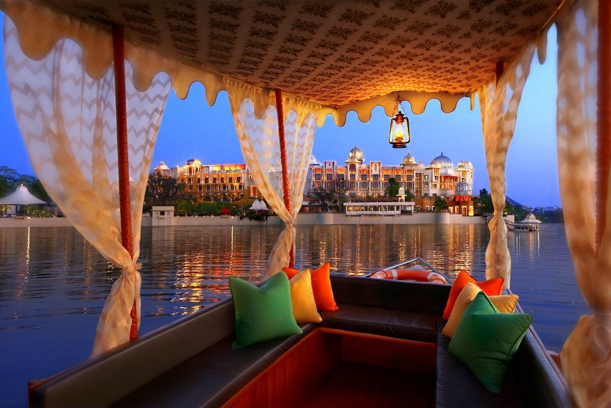 sail a shikara or boat in udaipur under a sky of fireworks