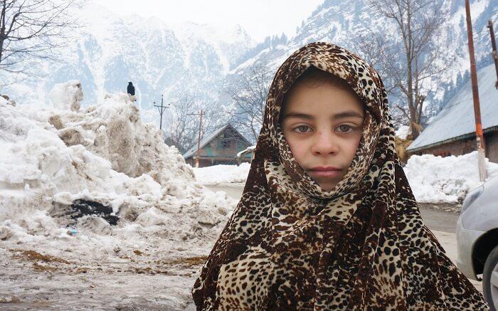 A Kashmiri girl posing for a photograph in Kashmir