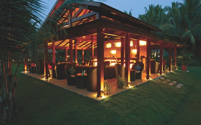 A beautiful wooden resort well lit at night