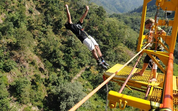 A boy in black t-shirt trying bungee jumping in Rishikesh
