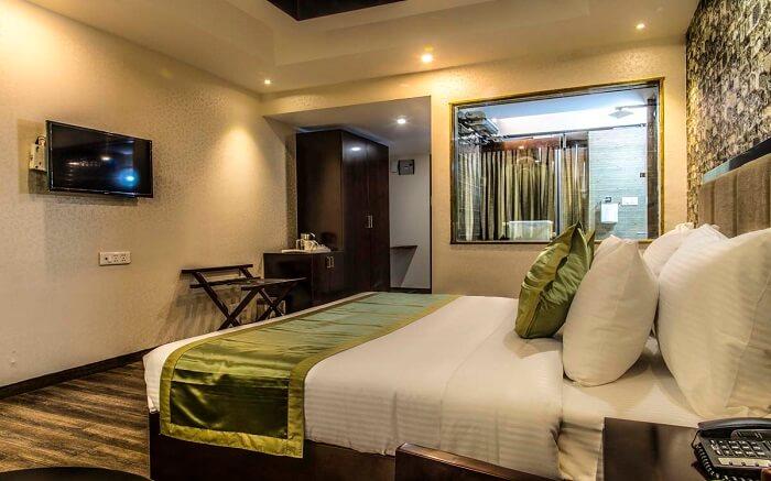 A lavishing resort room with tv