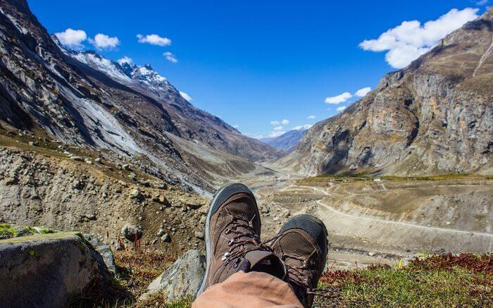 A man resting during hiking near Hampta Pass Trek