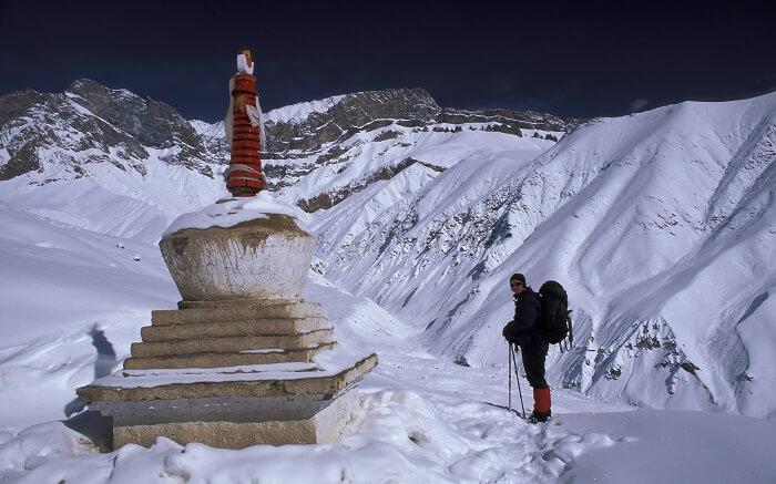 A traveler taking up a winter trek in the Himalayas in Kashmir