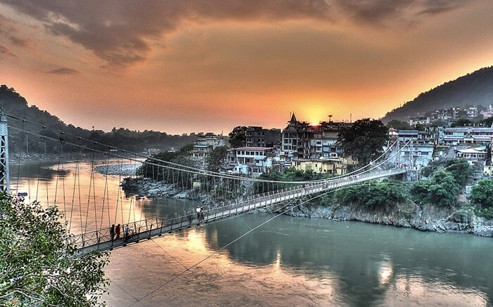 A view of a bridge in Rishikesh at sunrise
