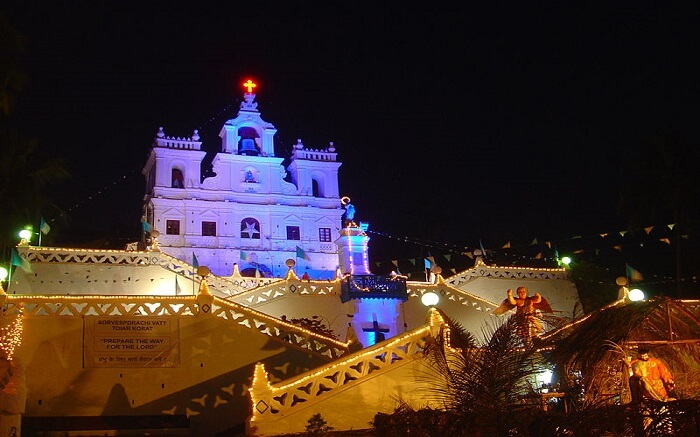 A well lit church at night in goa